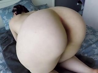 Huge ass teasing with a big dildo