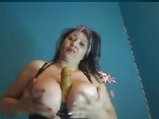 Chubby Colombian MILF with big tits plays with huge dildo