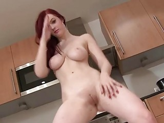 Slutty shaved redhead with big boobs is dancing