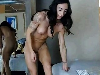 Muscular big ass babe shows off her muscles