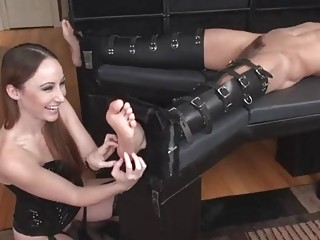 Dominant brunette girl tickles guy