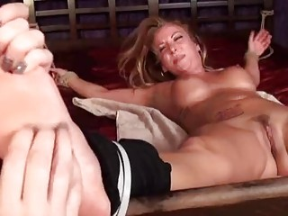 Bondage beauty is tickled on the bed