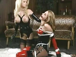 Busty blonde dominates a hot brunette lesbian