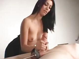 Brunette amateur gives a hot bondage handjob