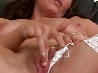 Beautiful brunette milf masturbates in white stockings