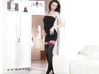 Sexy brunette is fingering her shaved pussy