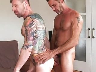 Athletic guys fill each other's holes with some sweet juice