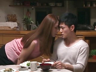 Entertaining Asian works her man's dick by a kitchen table