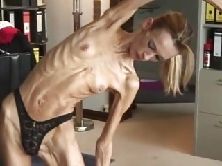 Flexible anorexic blonde showing her bony body