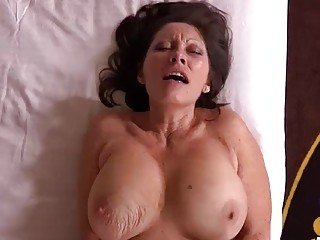 Amazing cougar gives a titjob and has hardcore anal sex