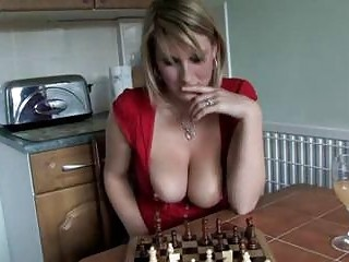 Downblouse MILF teases with big boobs while playing chess POV