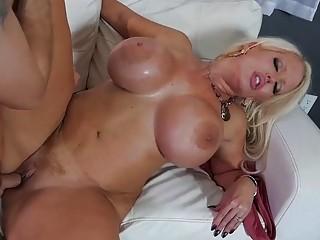 Veteran MILF with big tits Alura Jenson bangs on sofa