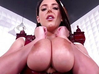 Domina shows off her big tits on camera