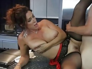 Sensational MILF in stockings gets fucked in the kitchen