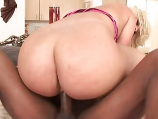 Blonde MILF gets rammed by a big black cock