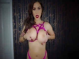 Amazing brunette shows off her big boobs on camera