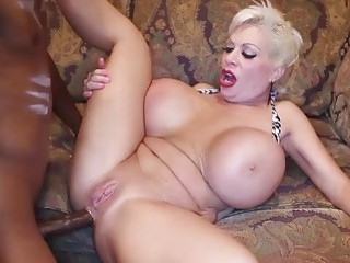 Blonde takes a big black cock inside of her