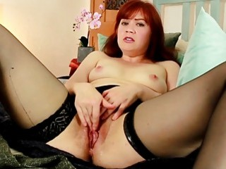 Redhead in stockings pleasures her hairy juicy cunt