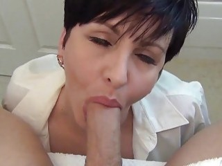 MILF talks dirty and teases a towering pecker