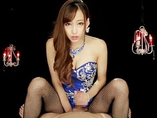 Sexy amateur Asian in fishnets gives a handjob