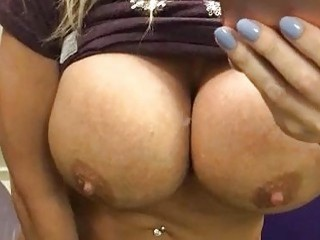 Muscular busty chick fingers her juicy cunt