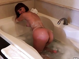 Striking MILF gives a POV bathroom blowjob and gets railed