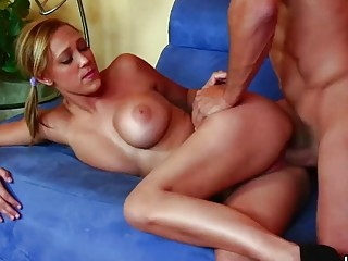 Tattooed girl with big tits fucks hardcore on a couch